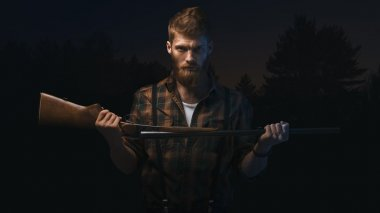 Angry man holding shotgun