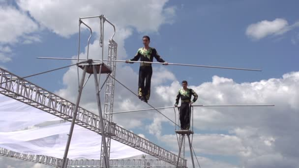 Two tightrope walker demonstrate mastery