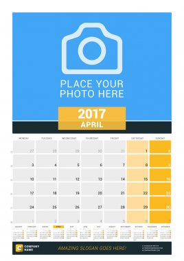April 2017. Wall Monthly Calendar for 2017 Year. Vector Design Print Template with Place for Photo and Year Calendar. Week Starts Monday