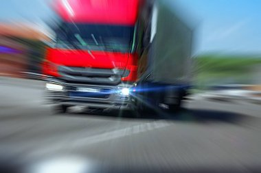 Truck with red cab on the road in motion. Accident rate. View from the cab of the car. Danger of collision
