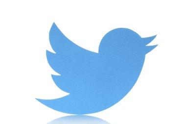 Twitter logotype bird printed on paper on white background