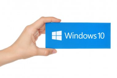 Hand holds Windows 10 logotype printed on paper