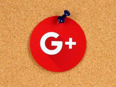 New Google Plus logo sign on cork bulletin board