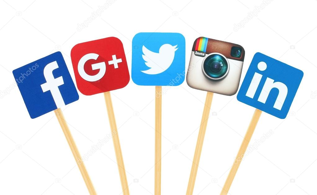 Popular social media logo signs printed on paper, cut and pasted on wooden stick: Facebook, Twitter, Google Plus, Instagram and Linkedin