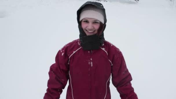 Woman making snow angel