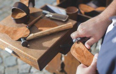Shoemaker making shoes
