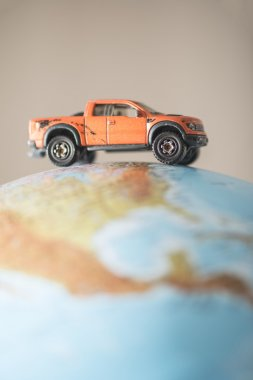 Offroad car on globe