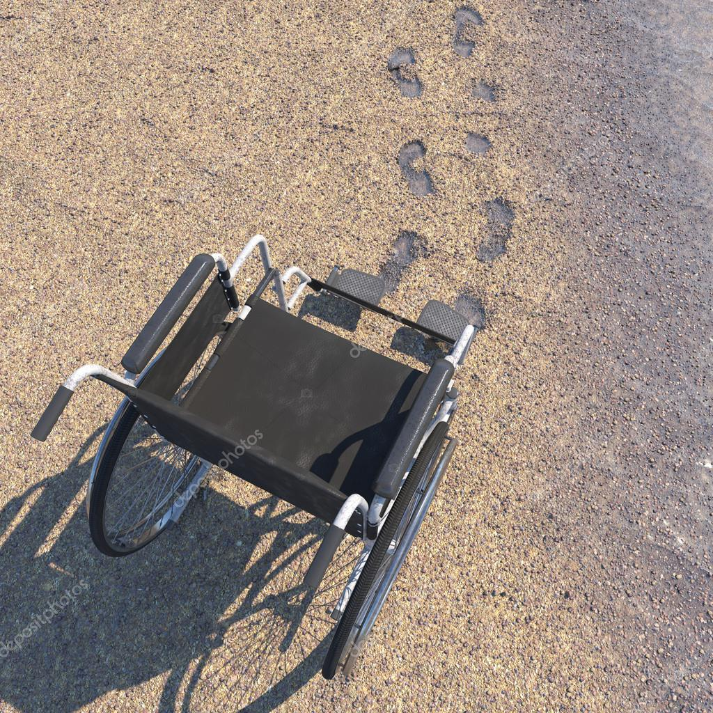 Empty wheelchair on a beach of sand with footprints concept background