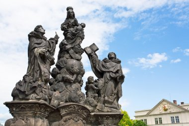 Statue of the Madonna, spanish priest Saint Dominic and italian Dominican friar and priest Thomas Aquinas in city Prague