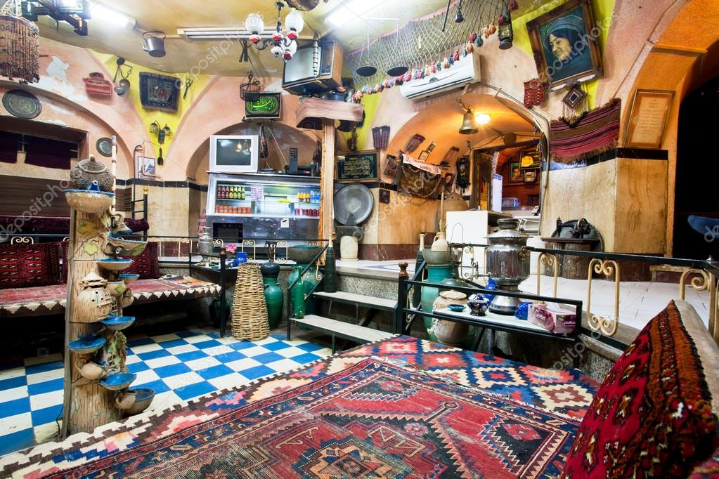 interior of historical persian cafe house with old carpets stock photo