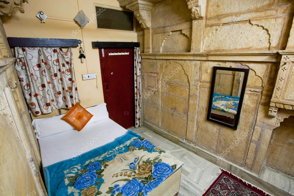jaisalmer india mar 1 poor interior design of a single room with a clean bed at indian hotel on march 1 2015 jaisalmer lies in the heart of the thar