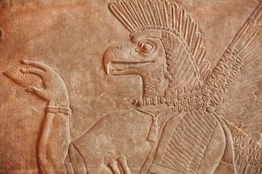 Historical Assyrian relief of bird face genie made in 850BC