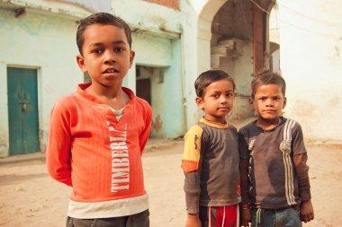 Unidentified poor children having fun on rural street of indian town