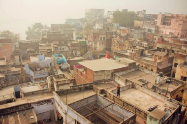 Fog over historical indian city with brick buildings with grunge walls
