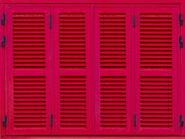 Window with red shutters. Close-up view.