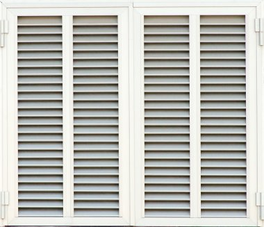 Window with white shutters. Close-up view.