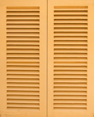 Window with beige shutters. Close-up view.