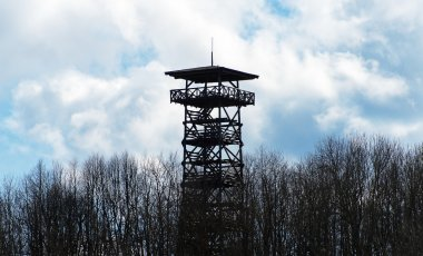 Wooden observation tower in the forest.