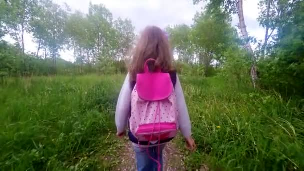 Little girl is going home from school.