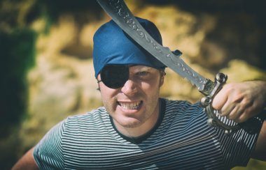 Angry male pirate with sword. Place for your text.