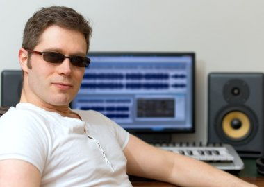 Male sound producer in recording studio.