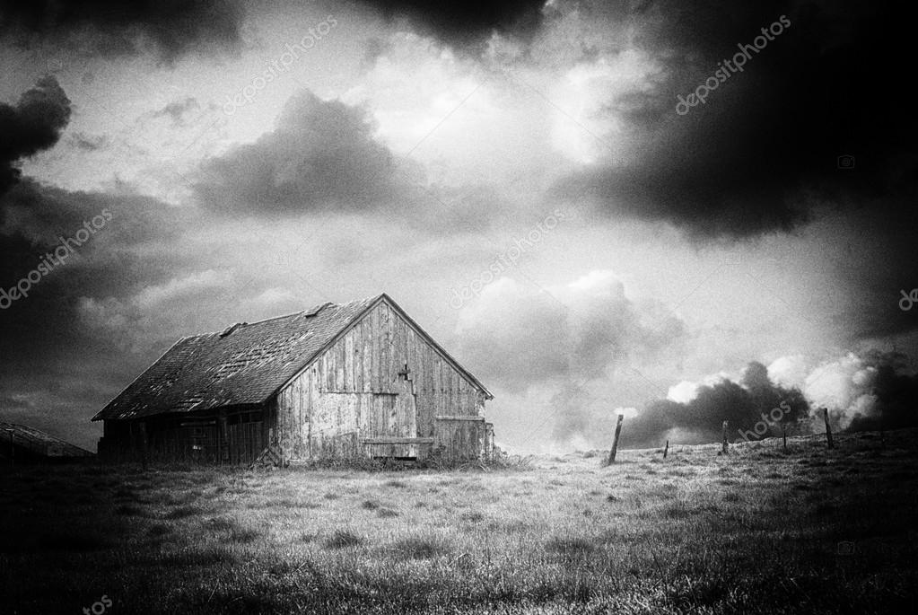 Old abandoned barn on a stormy night