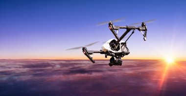 Drone for industrial works flying above clouds