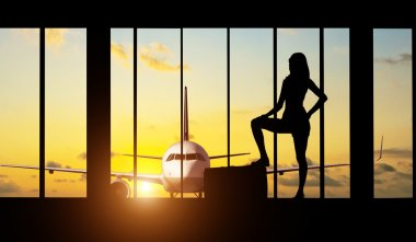 Woman silhouette at Airport - Concept of travel