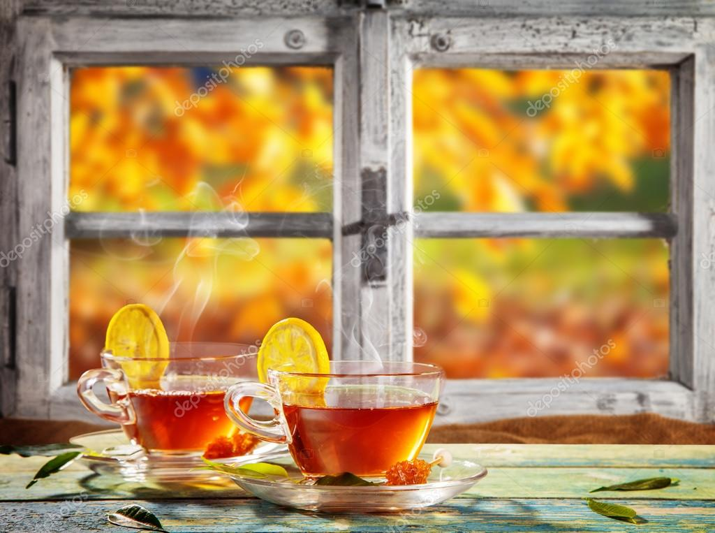 Autumn still life with tea cups on wooden planks