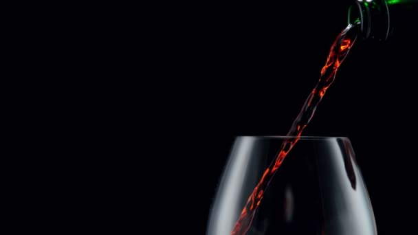 Super slow motion of pouring red wine into glass with camera motion. Filmed on high speed cinema camera, 1000 fps