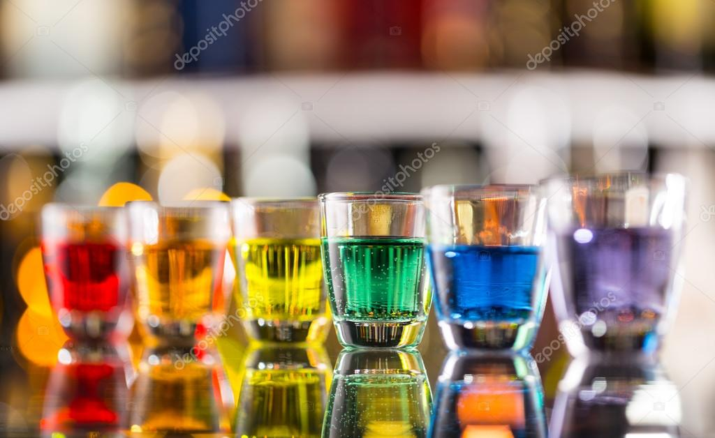 Variation of hard alcoholic shots on bar counter