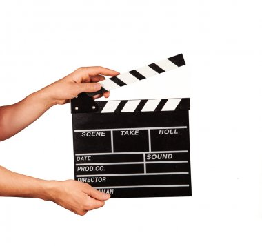 Man with film clapper on white background