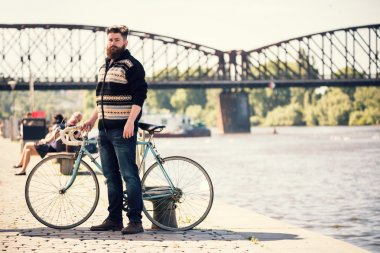 Trendy hipster young man with bycicle