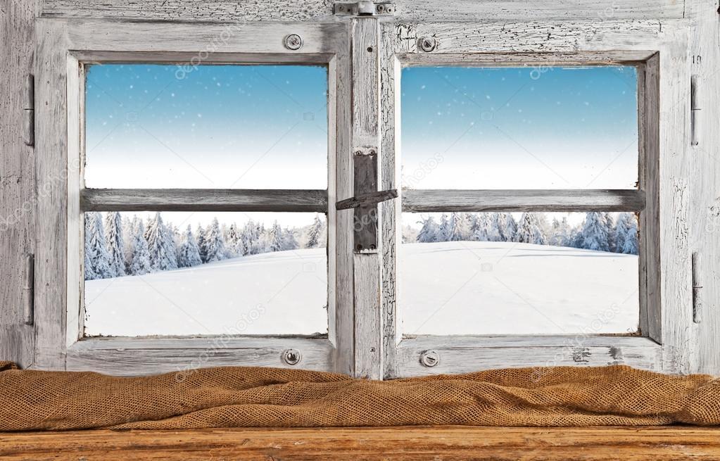 Vintage wooden window overlook winter landscape
