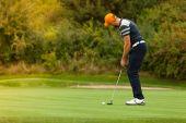 Fotografia Giocatore di golf con club