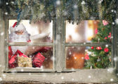 Fotografie Atmospheric Christmas window with Santa Claus