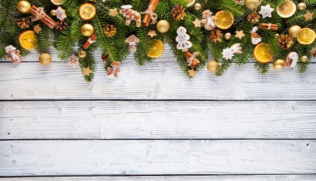 Christmas fir tree decoration on wooden background