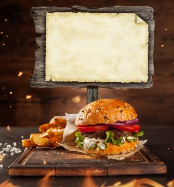 Home made hamburger with blank blackboard