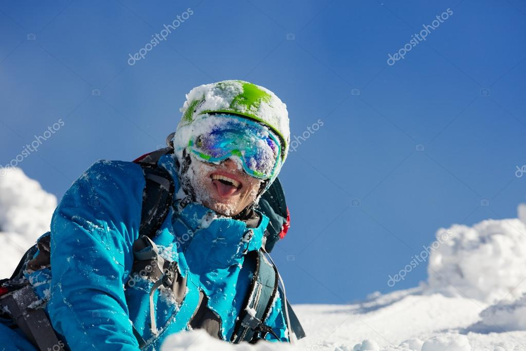 Portrait of skier during sunny day.
