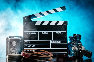 Retro film production accessories still life. Concept of filmmaking. Smoke effect on background stock vector