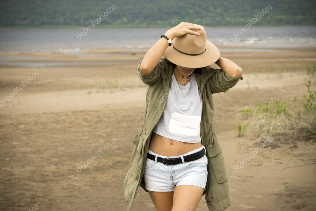 Young beautiful woman on a sandy beach