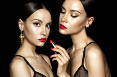 Two beautiful young ladys with red lipstick