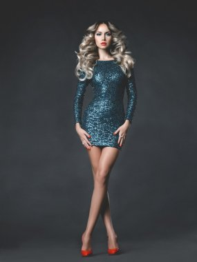 Beautiful blonde in sequined dress