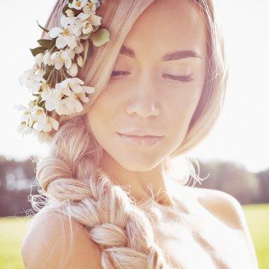 Romantic lady in wreath of apple trees