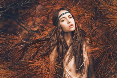 Beautiful lady hippie in fir forest