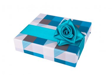blue-gray gift box with ribbon tied like a rose on a white background