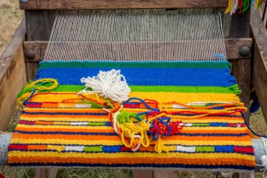 Antique loom machine. Bulgarian traditional culture.