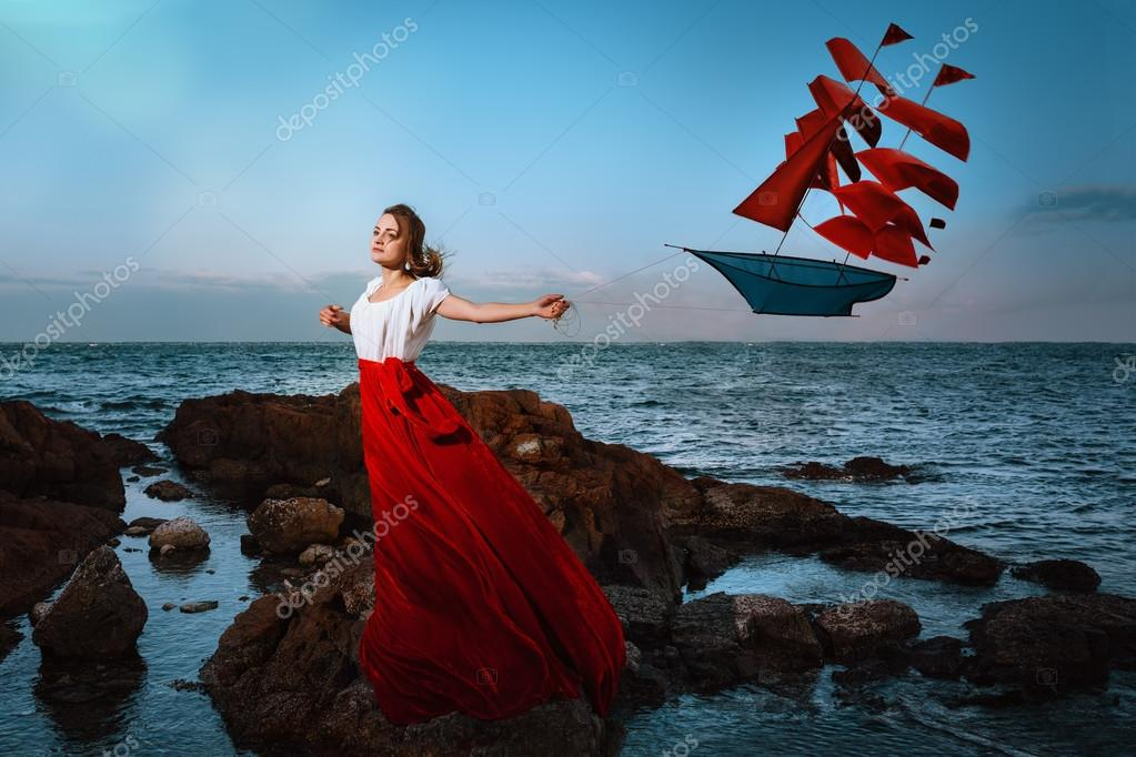 Beautiful girl holding a kite