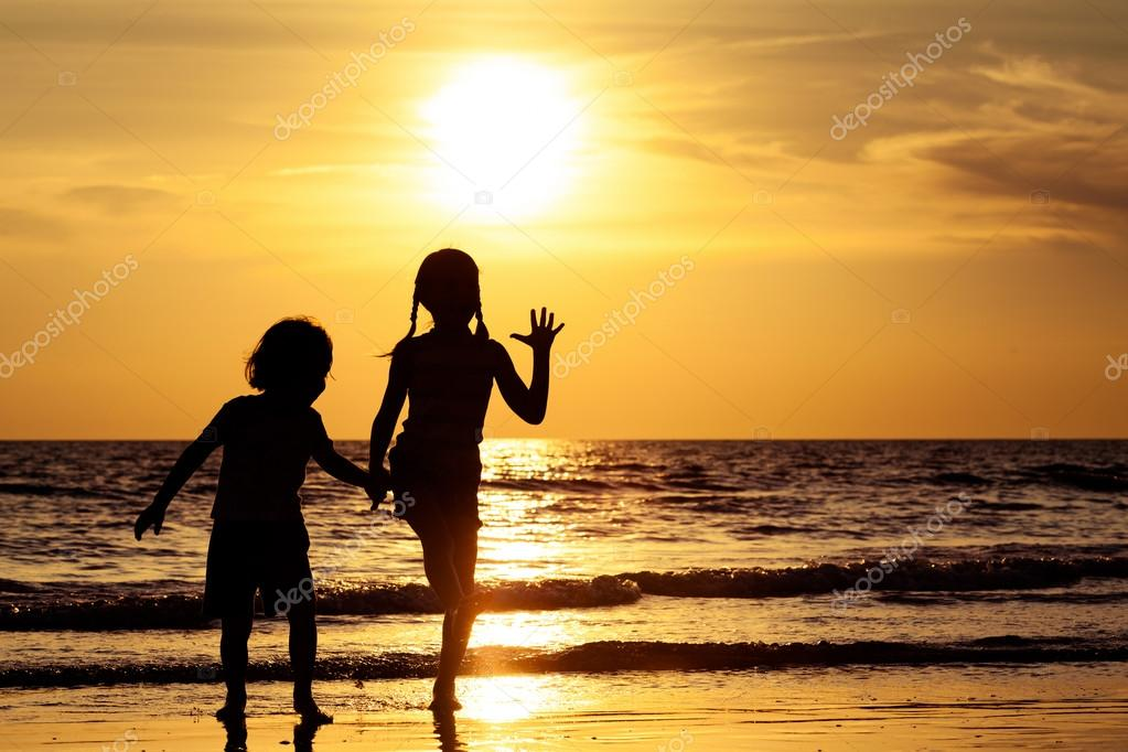 Happy children playing on the beach