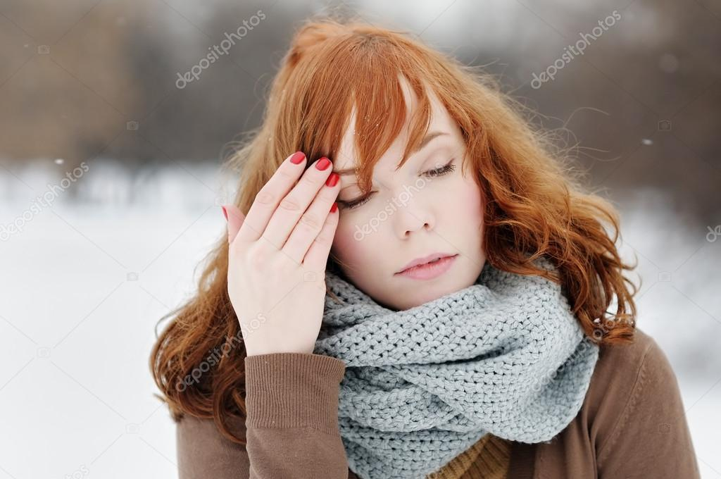 Outdoors portrait of sad young woman